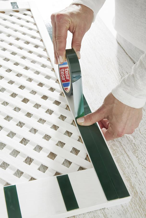 Remove any dust and apply two strips of tesa Powerbond® OUTDOOR on the reverse. Press for five seconds.