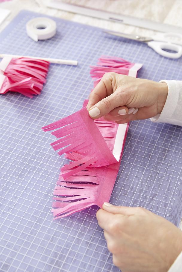 Unfold the strips to create a pompom