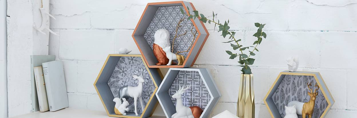 """Those who love """"hunting"""" at flea markets, in thrift stores, or even in their own basement, might find white porcelain animals. Partly painted with gold, silver or copper varnish, they celebrate a stylish comeback on the shelf - and they are easy to make."""