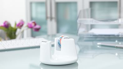 White-design desk tape dispenser with stop-pad technology for office tape.