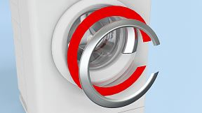 Decorative trims are mounted onto the front door of a washing machine.