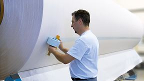 Repulpable splicing tapes for paper production
