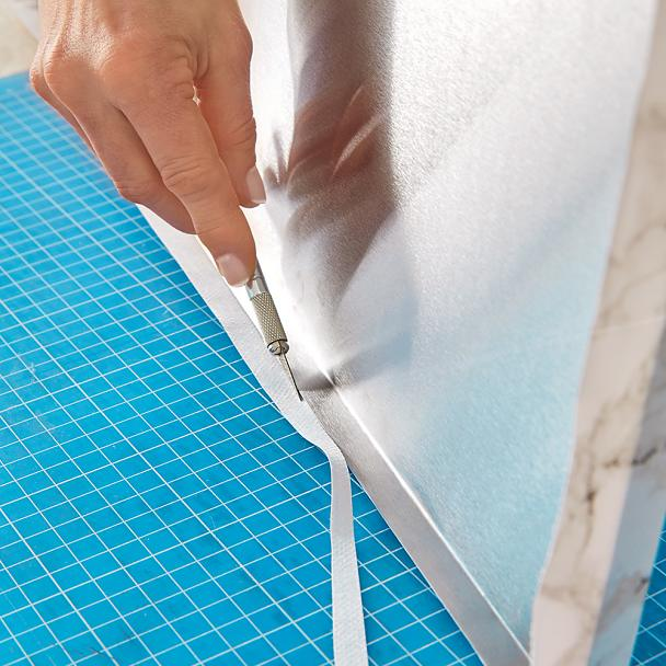 Trimming waxed cloth when making a make-up organiser
