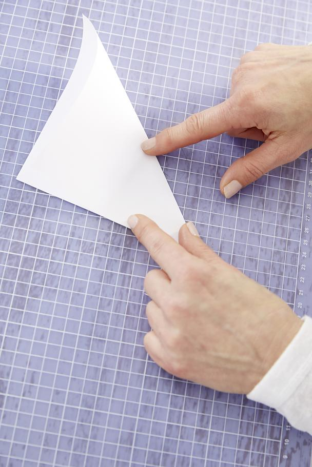 Fold a square piece of paper diagonally