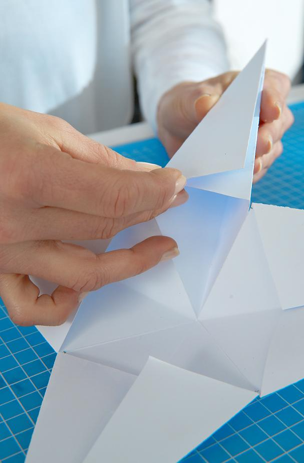 DIY Paper Stars / Step 9: Paste together the points