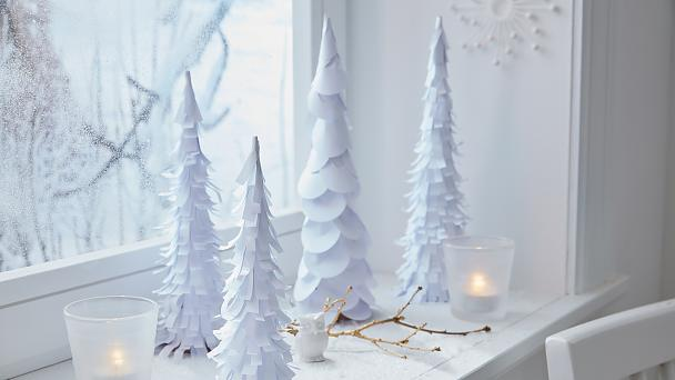 Many white paper trees on the windowsill bring the winter wonderland into your house, even if it's not snowing outside.