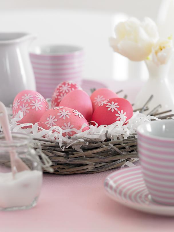 Isn't that lovely: Decorate your Easter eggs with punch-out paper flowers - they're easy to attach.