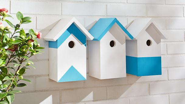 Create a row of stylish wooden bird houses