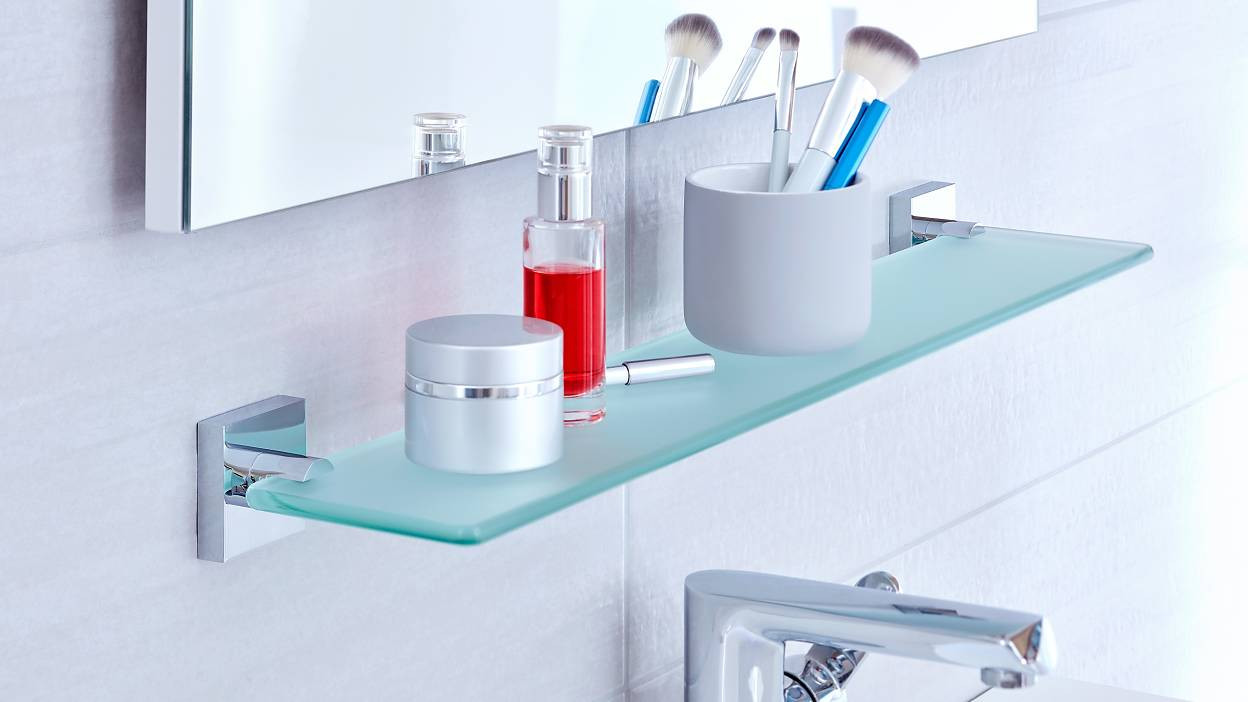 Use the space below your bathroom mirrors by mounting an elegant frosted glass shelf to the wall.