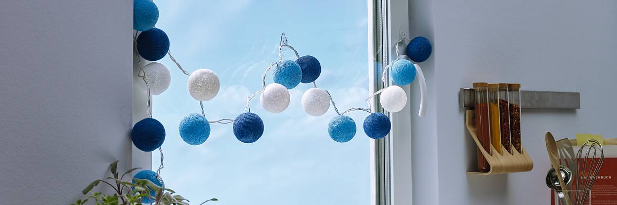 Transparent and nearly invisible adhesive hooks for mounting decorative objects on windows or mirrors.